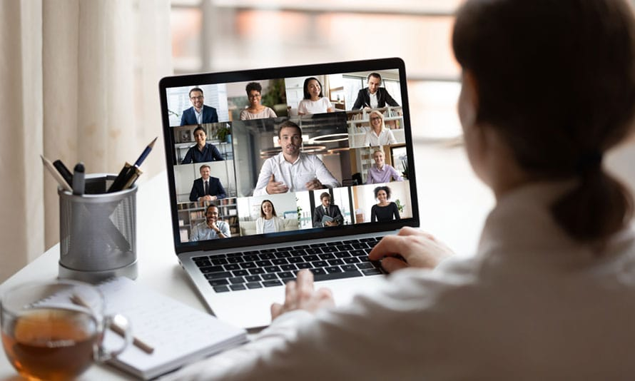 Woman at computer for online meeting.